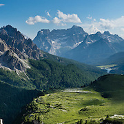 """The peaks of Cadini Group, Sorapiss Group, and Monte Cristallo rise (left to right) in the Dolomites, Veneto region, Italy, Europe. In the Cadini di Misurina, Cima Grande rises to 2999 meters (9839 feet), between Cima Piccola and Cima Ovest. Sorapiss and Monte Cristallo are in the Ampezzo Dolomites. The Cadini Group is in the Sesto Dolomites (Dolomiti di Sesto, or Sexten/Sextner/Sextener Dolomiten) which lie north of the Fiume Ansiei valley and Auronzo. From the Rifugio Auronzo toll road, hike for spectacular views around Tre Cime di Lavaredo (Italian for """"Three Peaks of Lavaredo,"""" called Drei Zinnen or """"Three Merlons"""" in German). The Dolomites are part of the Southern Limestone Alps. UNESCO honored the Dolomites as a natural World Heritage Site in 2009. Panorama stitched from 4 overlapping photos."""