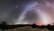 A 160&deg; panorama showing: <br /> - the Zodiacal Light (at right in the west)<br /> - the Milky Way (up from the centre, in the south, to the upper right)<br /> - the Zodiacal Band (faintly visible running across the frame at top)<br /> - the Gegenschein (a brightening of the Zodiacal Band at left of frame in the east in Leo)<br /> <br /> Along the Milky Way are dark lanes of interstellar dust, aprticularly in Taurus above and to the right of Orion. Red nebulas of glowing gas also lie along the Milky Way, such as Barnard&rsquo;s Loop around Orion.<br /> <br /> The Zodiacal Light, Band and Gegenschein all lie along the ecliptic, as do Mars, Venus and Jupiter shown here. <br /> <br /> Orion is at centre, in the south, with Canis Major and the bright star Sirius below and to the left of Orion. Canopus is just setting on the southern horizon at centre. <br /> <br /> To the right of Orion is Taurus and the Pleiader star cluster at the top of the Zodiacal Light pyramid. <br /> <br /> Venus is the bright object in the Zodiacal Light at right, in the west, while fainter Mars is below Venus. <br /> <br /> At far right at the frame edge, in the northwest, is the Andromeda Galaxy, M31. <br /> <br /> Jupiter is the bright object at upper left, in the east, in the Zodiacal Band, and near the Beehive star cluster. <br /> <br /> The Zodiacal Light, Band and Gegenschein are caused by sunlight reflecting off cometary and meteoric dust in the inner solar system. The Gegenschein, or &ldquo;counterglow,&rdquo; can be seen with the naked eye but is a subtle and diffuse brightening of the sky in the spot opposite the Sun. It is caused by sunlight reflecting directly back from comet dust, with the effect greatest at the point opposite the Sun. <br /> <br /> Glows like the Zodiacal Light require reasonably dark skies, but the fainter Zodiacal Band and Gegenschein require very dark skies.<br /> <br /> Glows on the horizon are from distant SIlver City, Las Cruces and El Paso. The brighter 