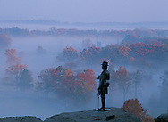 Pennsylvania. General Warren stands on Little Round Top in Gettysburg National Military Park, overlooking Valley of Death.Page 100 These United States Book