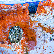 Natural arch in snow, Bryce Canyon National Park, Utah
