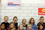 School children make faces as U.S. Democratic presidential candidate John Edwards speaks to potential voters during a campaign stop in Harlan, Iowa October 16, 2007.