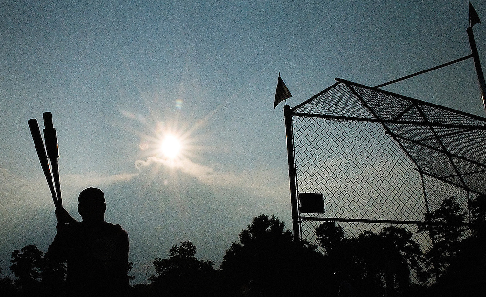 On deck, Judges Bench right fielder Howard Calk, 47, from Federal Hill, takes some warm up swings before approaching the batters box during one of the Wooden Bat Softball league games against Crab Shanty.