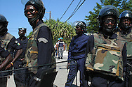 Haitian security forces, backed by United Nations peacekeepers, stand guard during a presidential campaign event organized by Haiti's wealthy business elite. Port-au-Prince, Haiti, January 16, 2006.