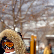 SHOT 12/28/2003 - Olga Solomina of Miami, Fla. waits for friends and family at the base of Aspen Mountain Sunday December 28, 2003. She said she used to model in Europe and Paris and was born in Russia. New Year's and Halloween are the busiest times of the year in the high-end resort town of Aspen. Finding a hotel room or restaurant reservation can be a challenge to say the least and prices tend to be even higher than normal because of the high demand. She was staying in Aspen, Co. for New Year's Eve. Aspen has become famous as a playground for the rich and beautiful..(Photo by Marc Piscotty/ © 2003)