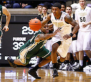WEST LAFAYETTE, IN - DECEMBER 29: Brandon Britt #12 of the William & Mary Tribe reaches in for the ball as Ronnie Johnson #3 of the Purdue Boilermakers dribbles the up court at Mackey Arena on December 29, 2012 in West Lafayette, Indiana. (Photo by Michael Hickey/Getty Images) *** Local Caption *** Brandon Britt; Ronnie Johnson