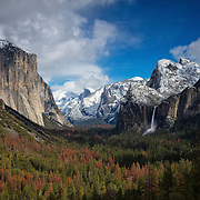 A winter storm clears over the Yosemite Valley as seen from Tunnel View in Yosemite National Park, California. El Capitan, a 7,573-foot (2,308 meter) granit peak that's one of the most prominent in Yosemite is visible at left. Half Dome, an 8,836-foot (2,693-meter) granite peak that seems to be missing a large section, is in the background, just left of center. Bridalveil Fall, a 620-foot (189-meter) waterfall that's often the first waterfall people see in the park, is visible on the right.
