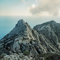 The high hills of the island.  Montecristo is the most distant island of the Tuscan Arcipelago form the Italian coast. It's a cone of granite with rugge valleys and peaks, the highest, Monte Fortezza is 654 meters. It has been a wildlife reserve since 1971. Federico Scoppa/CAPTA