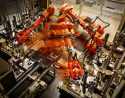 Robots assembling engine parts at volvo