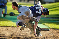 Coeur d'Alene Lumbermen's Colin Comack makes an acrobatic move at home plate to successfully avoid the tag from Kyle Knigge from the Lewis-Clark Twins during their game Tuesday at McEuen Field.
