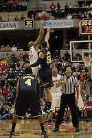 Ohio State center Dallas Lauderdale (52) wins the opening tip against Michigan forward Jordan Morgan (52) in the first half of the Big Ten Tournament semifinals in Indianapolis, on March, 11, 2011, at Conseco Fieldhouse. Ohio State defeated Michigan 68-61.