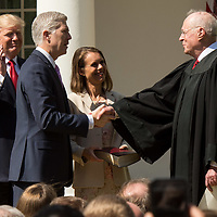 Associate Supreme Court Justice Neil Gorsuch, second left, shakes hands with Supreme Court Justice Anthony Kennedy, who swore him in, right, while U.S. President Donald J. Trump Gorsuch's wife Louise look on in the Rose Garden of the White House. Gorsuch replaces the seat vacated by Antonin Scalia when he died.