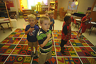 Kindergarten student Jon Lewis recites the Pledge of Allegiance on the first day of school at Bramlett Elementary in Oxford, Miss. on Thursday, August 4, 2011.  (AP Photo/Oxford Eagle, Bruce Newman)