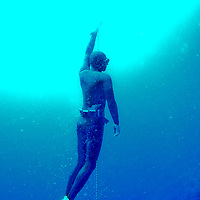 """A free diver ascends inside the Blue Hole off the coast of Dahab, Egypt. The Blue Hole is notorious for the number of diving fatalities which have occurred there, earning it the sobriquet """"World's Most Dangerous Dive Site"""" and the nickname """"Diver's Cemetery"""". The site is signposted by a sign that says """"Blue hole: Easy entry"""". Accidents are frequently caused when divers attempt to find the tunnel through the reef (known as """"The Arch"""") connecting the Blue Hole and open water at about 52 m depth. According to dive experts roughly 10 people die each year. April 2012."""