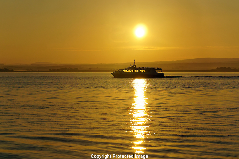 Cruise at Sunrise on the Moray Firth, photographed from the Black Isle, Scotland.