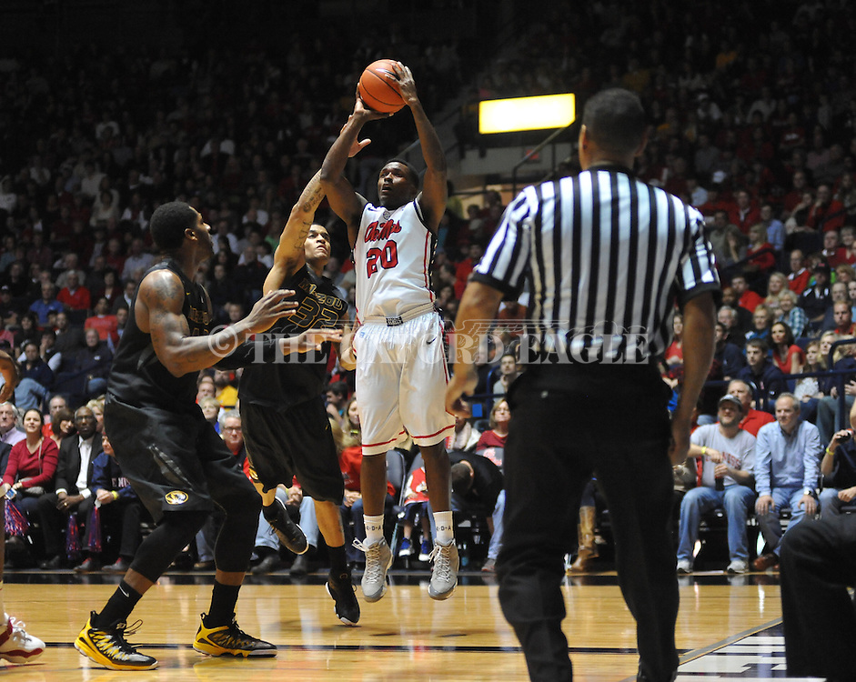 "Ole Miss' Nick Williams (20) vs. Missouri's Jabari Brown (32) at the C.M. ""Tad"" Smith Coliseum on Saturday, January 12, 2013. Ole Miss defeated #10 ranked Missouri 64-49."