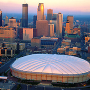 Aerial view Minneapolis Metro dome, Home of the Minnesota Vikings Football team, and skyline in October 1995 at Sunrise ([Julia Robertson]/via AP Images)