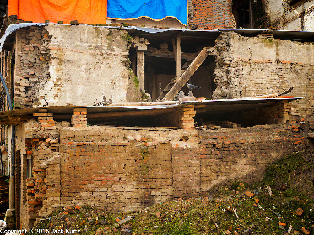 02 AUGUST 2015 - BHAKTAPUR, NEPAL:   A home in Bhaktapur left uninhabitable by the Nepal earthquake. Bhaktapur was badly damaged in the earthquake the hit Nepal in April 2015. The Nepal Earthquake on April 25, 2015, (also known as the Gorkha earthquake) killed more than 9,000 people and injured more than 23,000. It had a magnitude of 7.8. The epicenter was east of the district of Lamjung, and its hypocenter was at a depth of approximately 15 km (9.3 mi). It was the worst natural disaster to strike Nepal since the 1934 Nepal–Bihar earthquake. The earthquake triggered an avalanche on Mount Everest, killing at least 19. The earthquake also set off an avalanche in the Langtang valley, where 250 people were reported missing. Hundreds of thousands of people were made homeless with entire villages flattened across many districts of the country. Centuries-old buildings were destroyed at UNESCO World Heritage sites in the Kathmandu Valley, including some at the Kathmandu Durbar Square, the Patan Durbar Squar, the Bhaktapur Durbar Square, the Changu Narayan Temple and the Swayambhunath Stupa. Geophysicists and other experts had warned for decades that Nepal was vulnerable to a deadly earthquake, particularly because of its geology, urbanization, and architecture.      PHOTO BY JACK KURTZ
