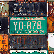 "SHOT 7/08/2007 - A variety of old and outdated Colorado license plates adorn the side of a home in Crested Butte, Colo. Often called ""the last great Colorado ski town"", Crested Butte is a small resort town located in Gunnison County in the U.S. state of Colorado. A former coal mining hub, Crested Butte is now a destination for skiing, mountain biking, and a variety of other outdoor activities. The Colorado state legislature has designated Crested Butte the wildflower capital of Colorado..(Photo by Marc Piscotty / © 2007)"