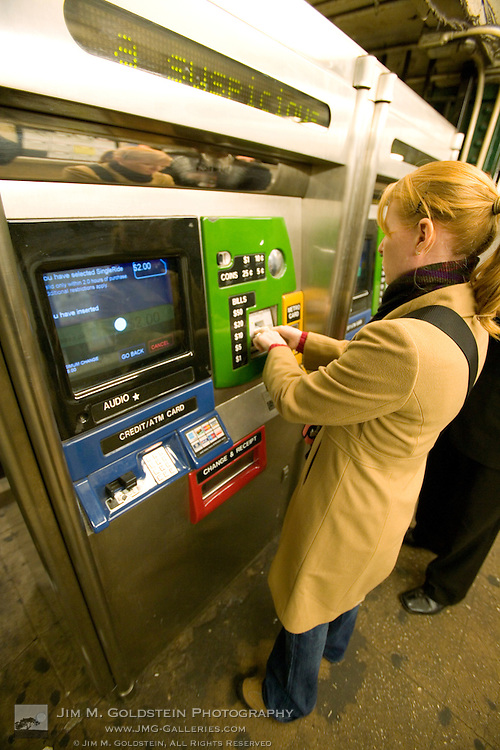 A public transit traveler get subway fare at a New York City transportation kiosk