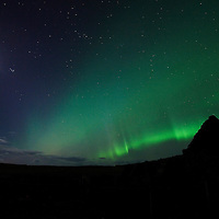 Aurora Borealis and full moon over Culkein-Stoer, Assynt, Highlands, Scotland.