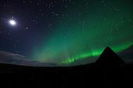 Aurora Borealis and full moon over Culkein-Stoer, Assynt, Highlands, Scotland.