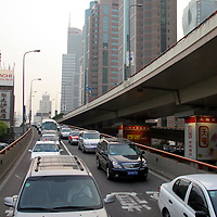Asia, China; Shanghai. Traffic on mutiple levels of freeways meander through Shanghai.