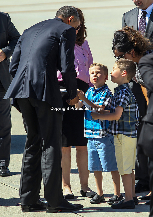 President Barack Obama greets with two young guest after his arrival at Los Angeles International Airport in Los Angeles on Saturday, Oct. 10, 2015. (AP Photo/Ringo H.W. Chiu)