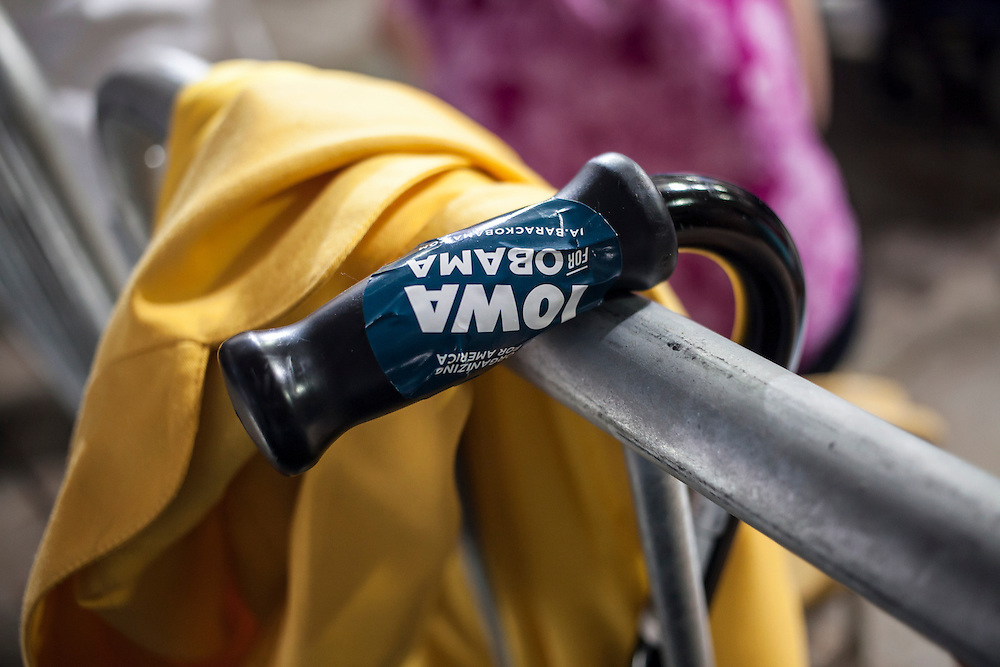 A cane with an Iowa for Obama sticker on the handle hangs over a bicycle rack as Vice President Joe Biden speaks at a campaign rally at the Port of Burlington during a two-day campaign swing through Iowa on Monday, September 17, 2012 in Burlington, IA.