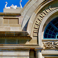 Railway Station Arch Entry in Fremantle, Australia<br /> Fremantle is a small port town in western Australia that neighbors Perth.  It is charming to walk among the well-preserved buildings that date from 1830 to the early 1900&rsquo;s; many of them reflect its merchant and shipping heritage.  This railway station fa&ccedil;ade was built in 1907 with brick and local Donnybrook stone.  It closed in 1979 yet re-opened four years later.  Notice the perched birds; they are a tribute to the Swan River that flows nearby.