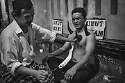 Terapi Bekam (Cupping Therapy) using buffalo horns, Jakarta, Indonesia 2016 - Photograph by David Dare Parker