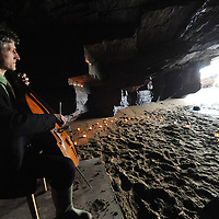 Acclaimed cellist Jan Hendrik Rubel rehearsing in a secret cave near Kinsale for his concert during Kinsale Arts Festival.