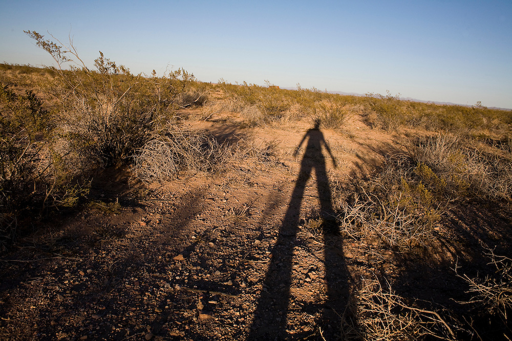 The photographer casts a shadow in the desert near Columbus, NM, on Tuesday, Jan. 29, 2008.