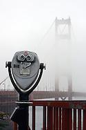 A view of the Golden Gate Bridge hidden in the fog.