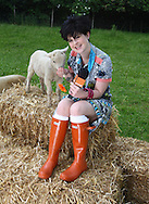 Kelly Osborne pictured promoting her Glastonbury Video Diaries which she will film on behalf of sponsors Orange. Photocall at  Hackney City Farm.