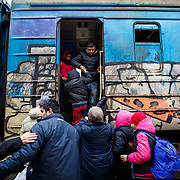 Refugees board the train about to depart to the Croatian-Serbian border; on their way to Western Europe with the hope of finding a peaceful future. Presevo, Serbia, January 2016.