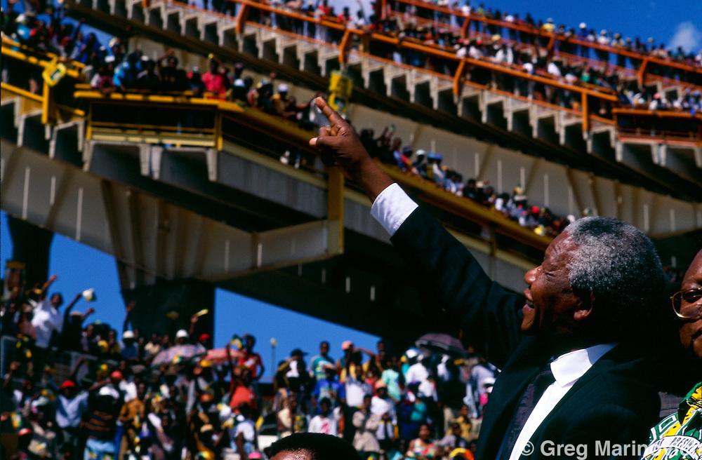 Nelson Mandela at a rally, Mmbatho, Bophuthatswana homeland, with security, 1994, South Africa.
