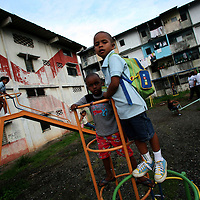 Kids play in a playground in San Miguel, a poor barrio in Panama City, Panama on Saturday, September 8, 2007. (Photo/Scott Dalton).