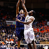 WEST LAFAYETTE, IN - JANUARY 02: Joseph Bertrand #2 of the Illinois Fighting Illini shoots the ball against Rapheal Davis #35 of the Purdue Boilermakers  at Mackey Arena on January 2, 2013 in West Lafayette, Indiana. (Photo by Michael Hickey/Getty Images) *** Local Caption *** Joseph Bertrand; Rapheal Davis