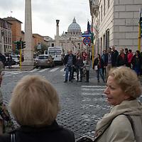 Woman talk while waiting at a crosswalk near the Vatican