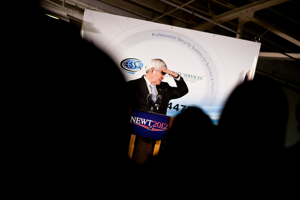 Republican presidential candidate Newt Gingrich speaks at a campaign meeting with employees of Global Security Services on Monday, December 19, 2011 in Davenport, IA.