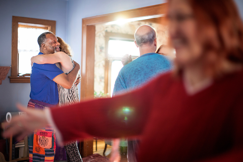 David Byrd, far left, hugs Becky Shipman in a pre-cuddle exercise during a Cuddle Party at a home in Minneapolis January 9, 2015. The exercise involved asking for permission to hug and clearly expressing one's desires (non-sexual) to either be touched or not be touched.