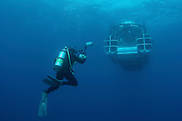Eric Cheng photographs a submarine off of Cocos Island, Costa Rica