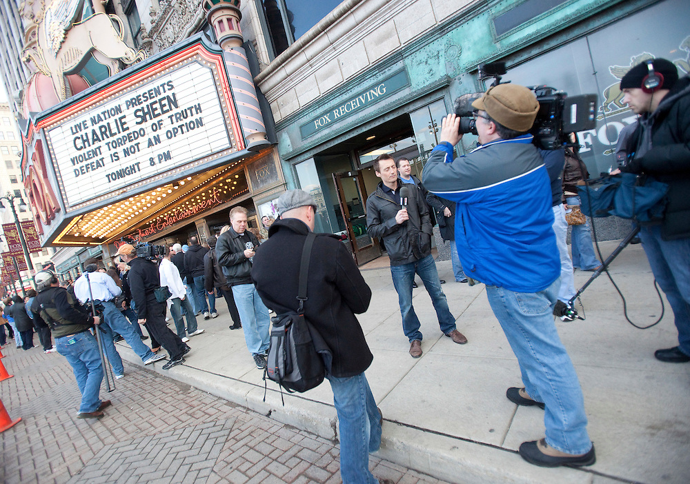 Dozens of media gather in front of the Fox Theatre in Detroit, Michigan April 2, 2011 where Sheen starts the cross country tour of his show &quot;Violent Torpedo of Truth/Defeat is Not an Option&quot;.<br /> AFP/GEOFF ROBINS/STR