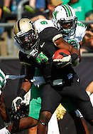 WEST LAFAYETTE, IN - SEPTEMBER 29: O.J. Ross #4 of the Purdue Boilermakers is tackled from behind by Dominick LeGrande #6 of the Marshall Thundering Herd at Ross-Ade Stadium on September 29, 2012 in West Lafayette, Indiana. (Photo by Michael Hickey/Getty Images) *** Local Caption *** O.J. Ross; Dominick LeGrande
