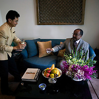 Bangkok, JUNE-15 : Prinz Asfa-Wossen Asserate in seiner &quot; Joseph Conrad&quot; Suite mit Butler im Mandarin Oriental Hotel.<br /> Prinz Asfa- Wossen Asserate ist nach Asien gereist, um eine Fahrt im legendaeren Orient Express zu erleben u darueber zu schreiben .