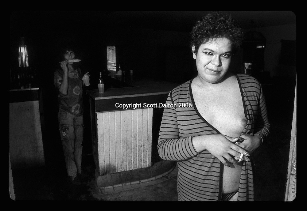 A transsexual prostitute stands in front of a bar in Boystown, in Nuevo Laredo Mexico, just across the US-Mexico border from Laredo, Texas. Boystown is a walled community, only one way in or out, which is home to the cities prostitution and red light bars. Many of the prostitutes who work there are transsexuals and transvestites. The idea behind the walled community is to isolate the activities associated with red light districts. (Photo/Scott Dalton)