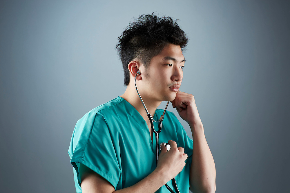 A portrait series representing the intense emotions that Doctors face.  A Asian male Doctor wearing a stethoscope, and green medical scrub suit shown.