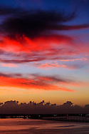 Light from the rising sun illuminates delicate clouds above Virginia Key, near Miami, Florida.<br /> WATERMARKS WILL NOT APPEAR ON PRINTS OR LICENSED IMAGES.