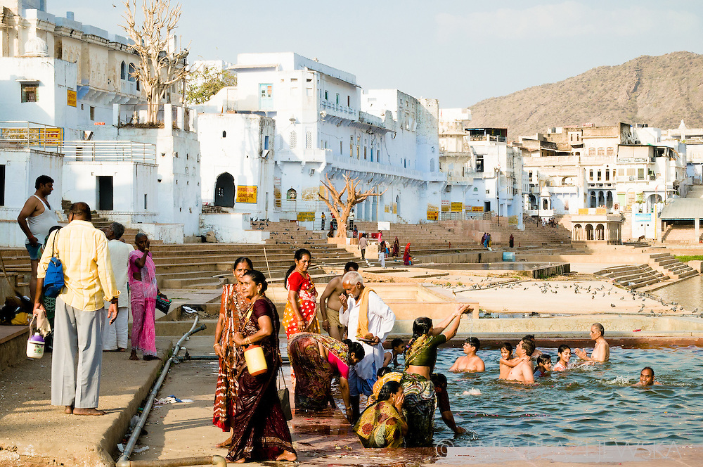 India, Pushkar. People taking bath in water of the holy lake in Pushkar.