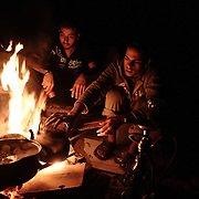 A homeless Palestinian family cooks on a bonfire on the rubble of their house in Jabalia in the northern Gaza Strip on January 23, 2009. A Hamas delegation from Gaza crossed into Egypt for talks to shore up the ceasefire with Israel which ended a 22-day assault on the coastal strip, a border official said. Israel and Hamas have observed their own ceasefires since January 18 when Israel ended Operation Cast Lead leaving a trail of devastation and 1,330 Palestinians dead, according to doctors. Egypt is trying to secure a durable ceasefire between Israel and Hamas and the reopening of crossings.